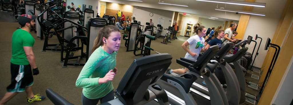 Students and community members run on treadmills in the S.H.A.P.E Facility