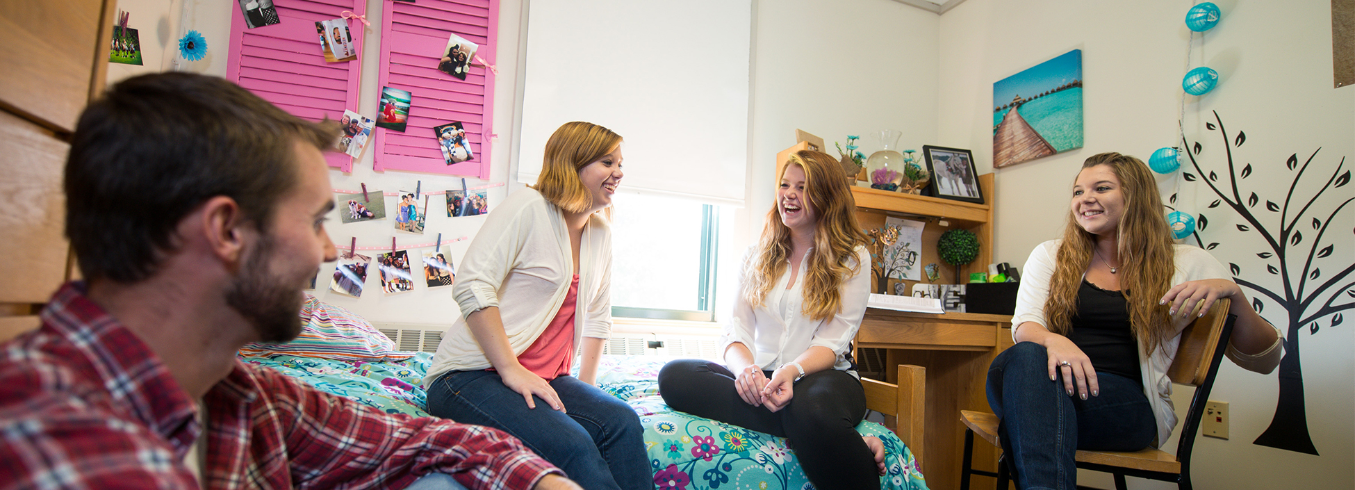 Students laugh and visit in one of the dormitories at the Randolph Center Campus
