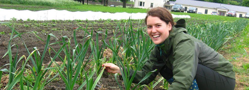Student gardening by Langevin, Randolph Center campus