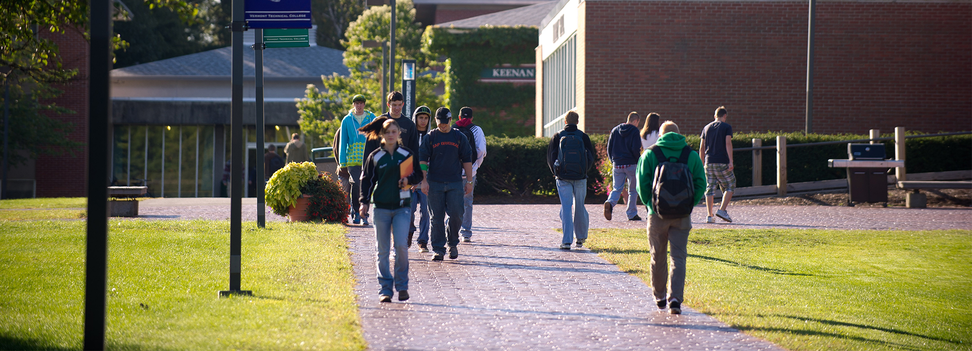 Students at the Randolph Center Campus walk to class past the Morey Dining Hall and Dormitory