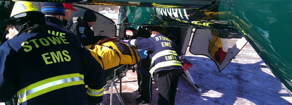 Paramedics load a helicopter with hurt patient