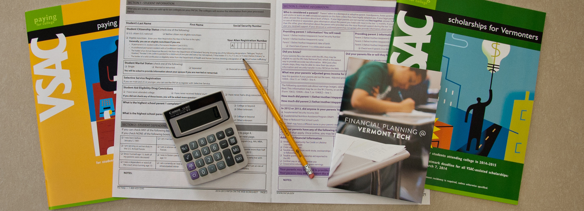 brochure calculator pencil