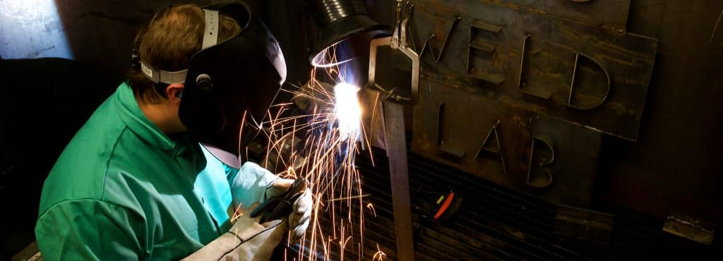 A student works in the Vermont Tech welding lab