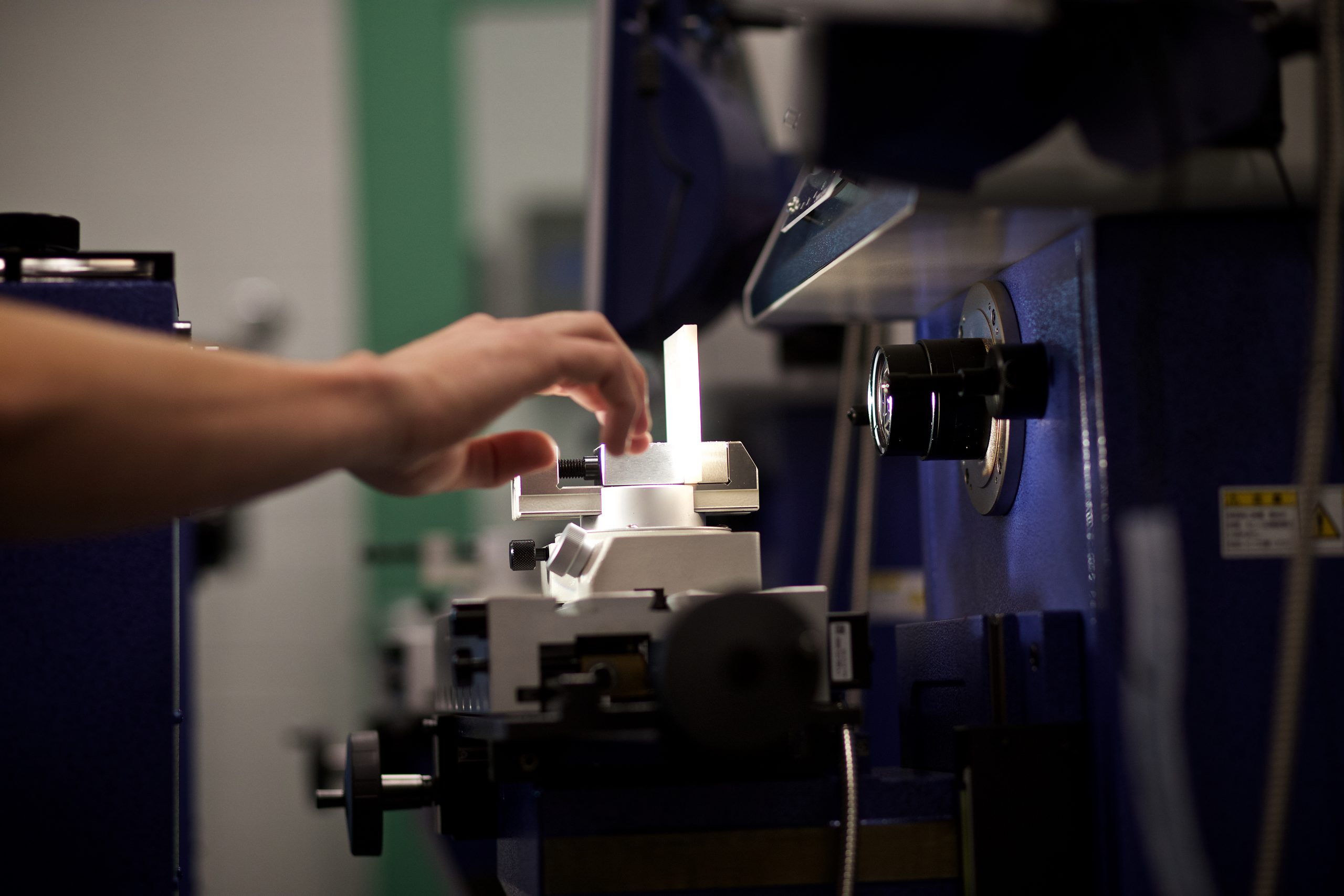 Vermont Tech students measures a manufacturing production piece in the metrology lab