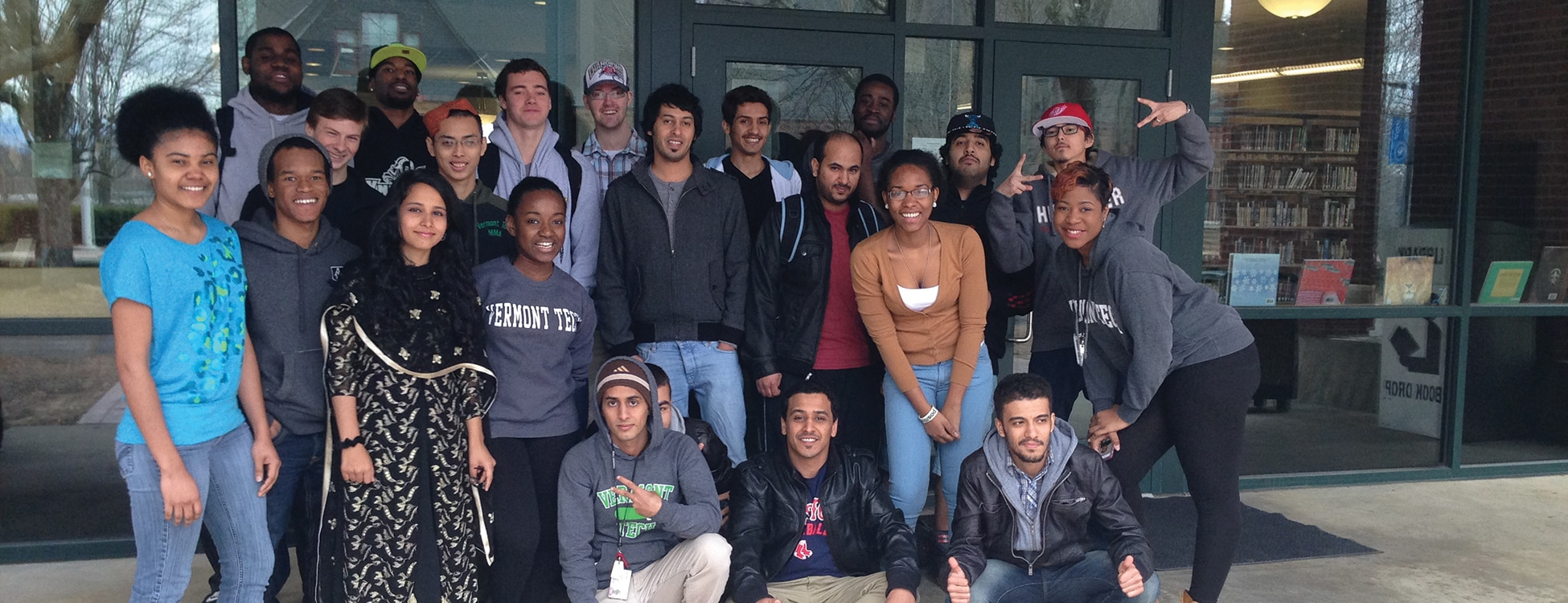 Vermont Tech's Multicultural Club members pose outside of the Hartness Library, student club, Randolph Center campus