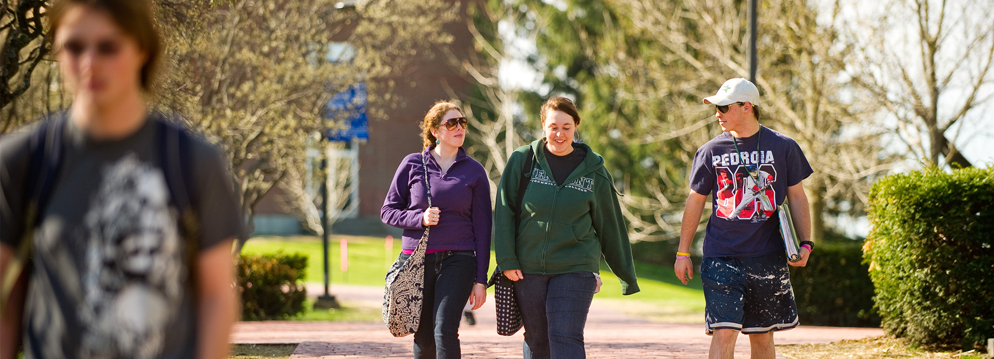 Female students walk to spring semester classes on the Randolph Center Campus