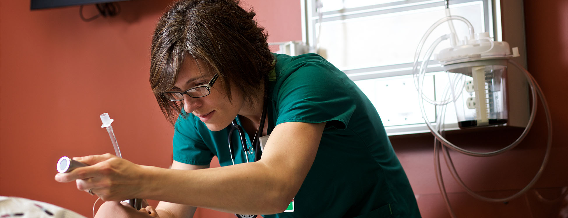 Kate Morrison, student, practices on a simulation man, respiratory therapy, healthcare, lab, hands on