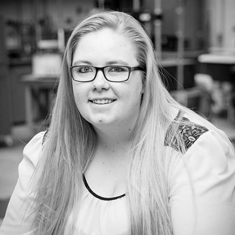 Katrina Hagan, girl with glasses, smiling in the civil engineering lab, Randolph Center campus