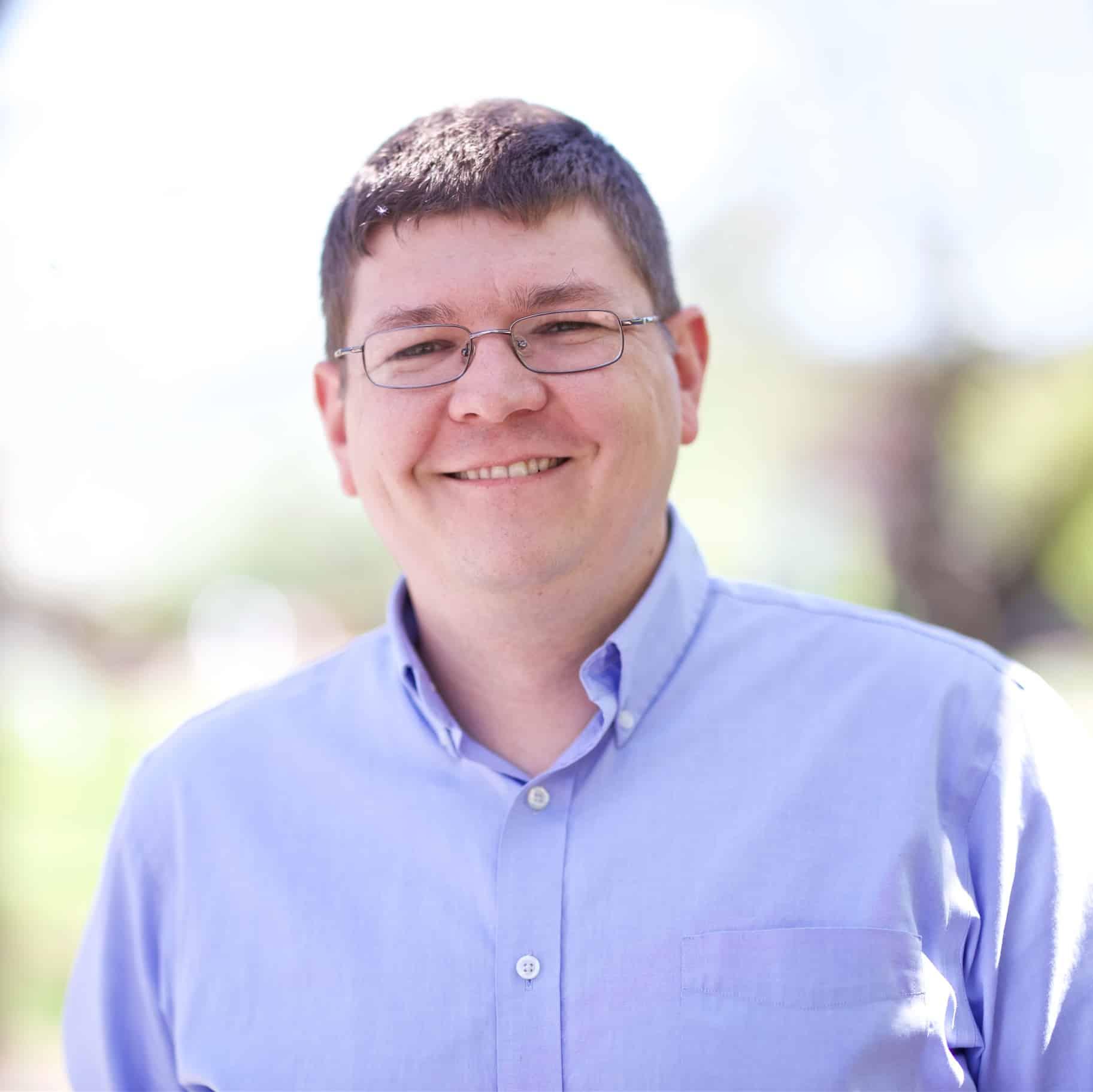 A photo of Professor Jeremy Ouellette, smiling