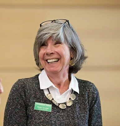 Robin Goodall, staff member, smiles while at a conference