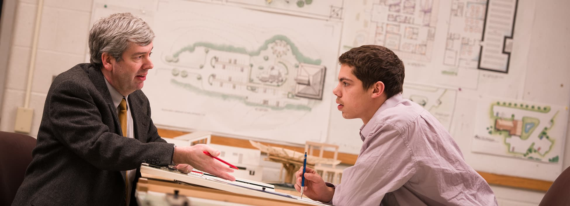 Professor Brad Miller works with a student in the Architectural Engineering Technology program