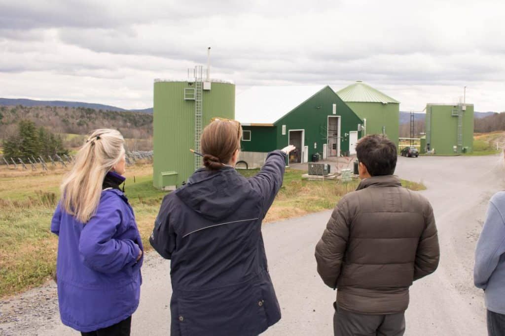 The group observes the biodigester from afar, Randolph Center campus