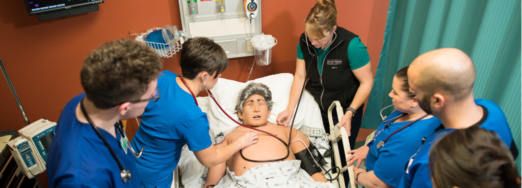 Nursing students working in the simulation lab on the Williston campus with nursing faculty