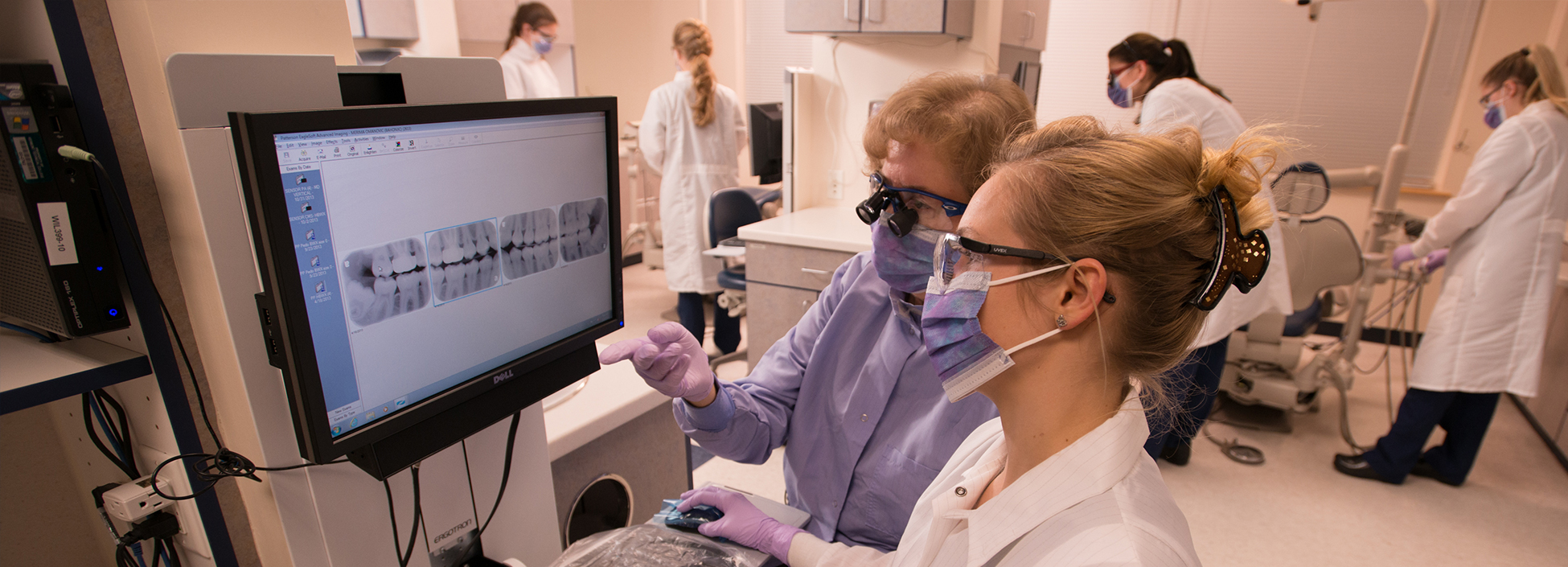 Dental Hygiene student and faculty examine x-rays at the Williston campus.