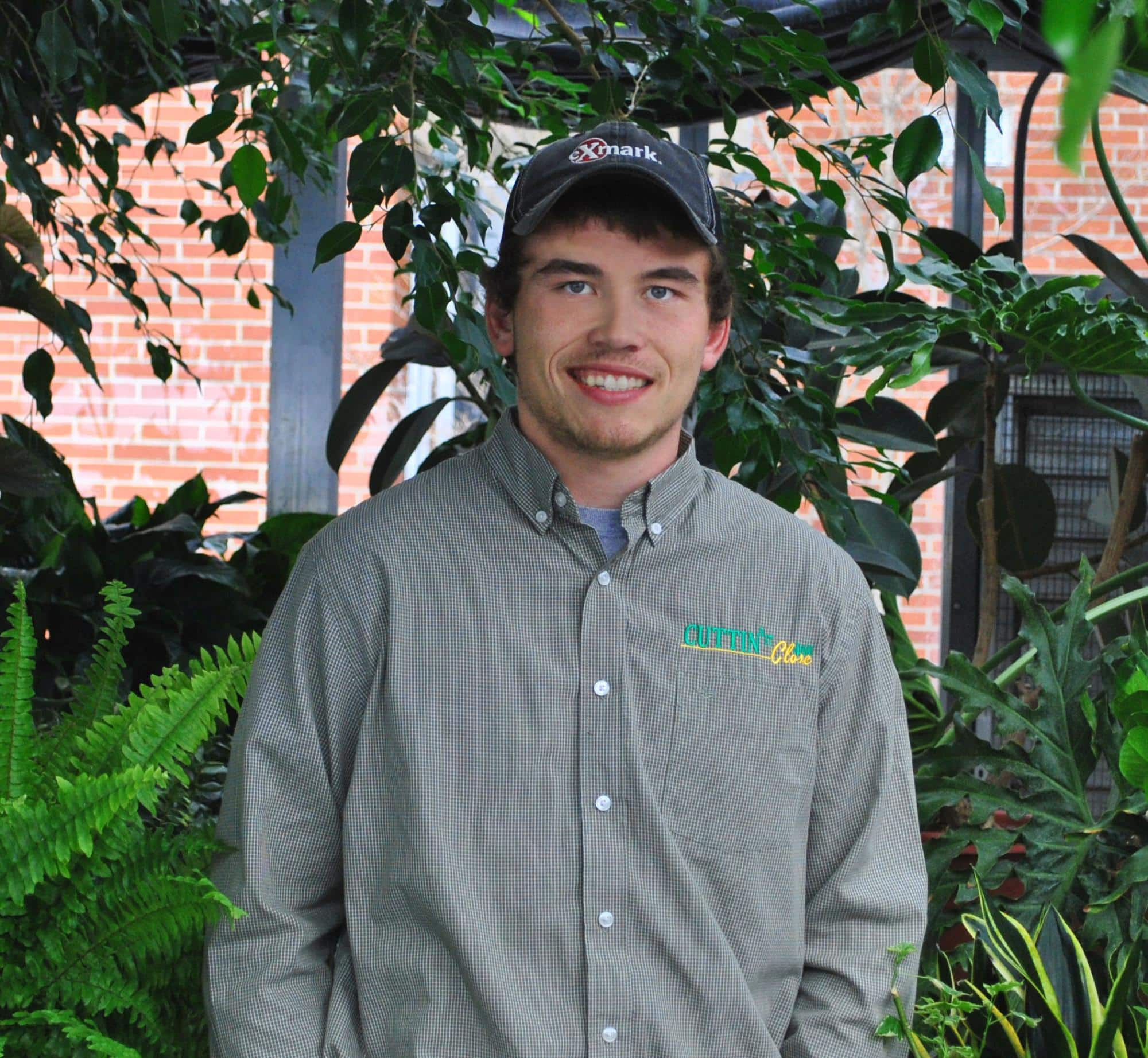 Jack Beauparland, student, stands in the greenhouse on the Randolph Center campus