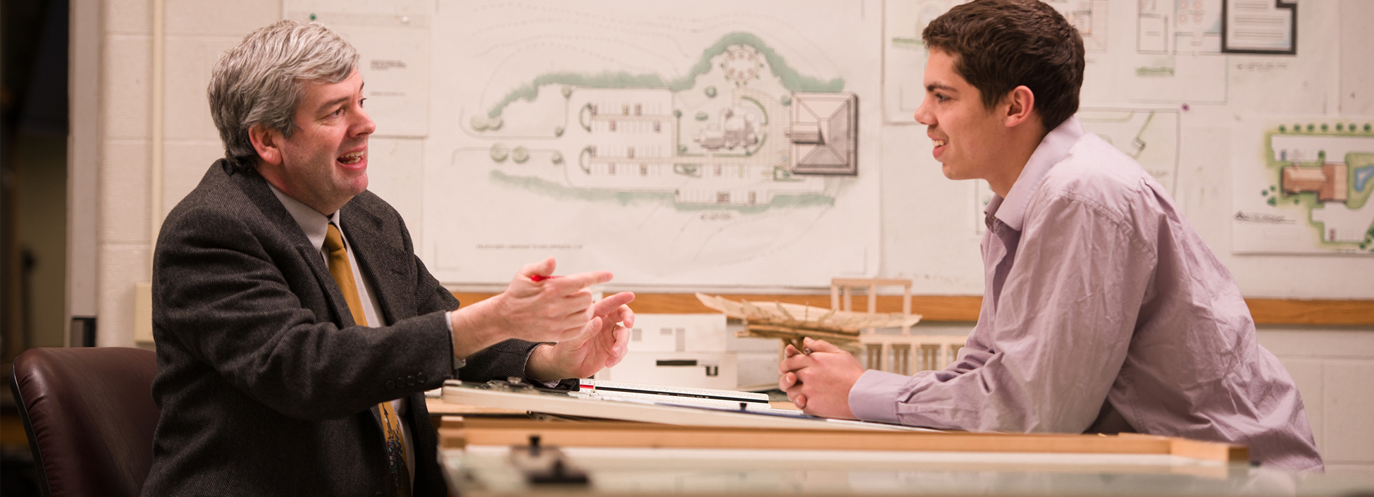 Professor Miller explains a lesson to a student, architectural engineering
