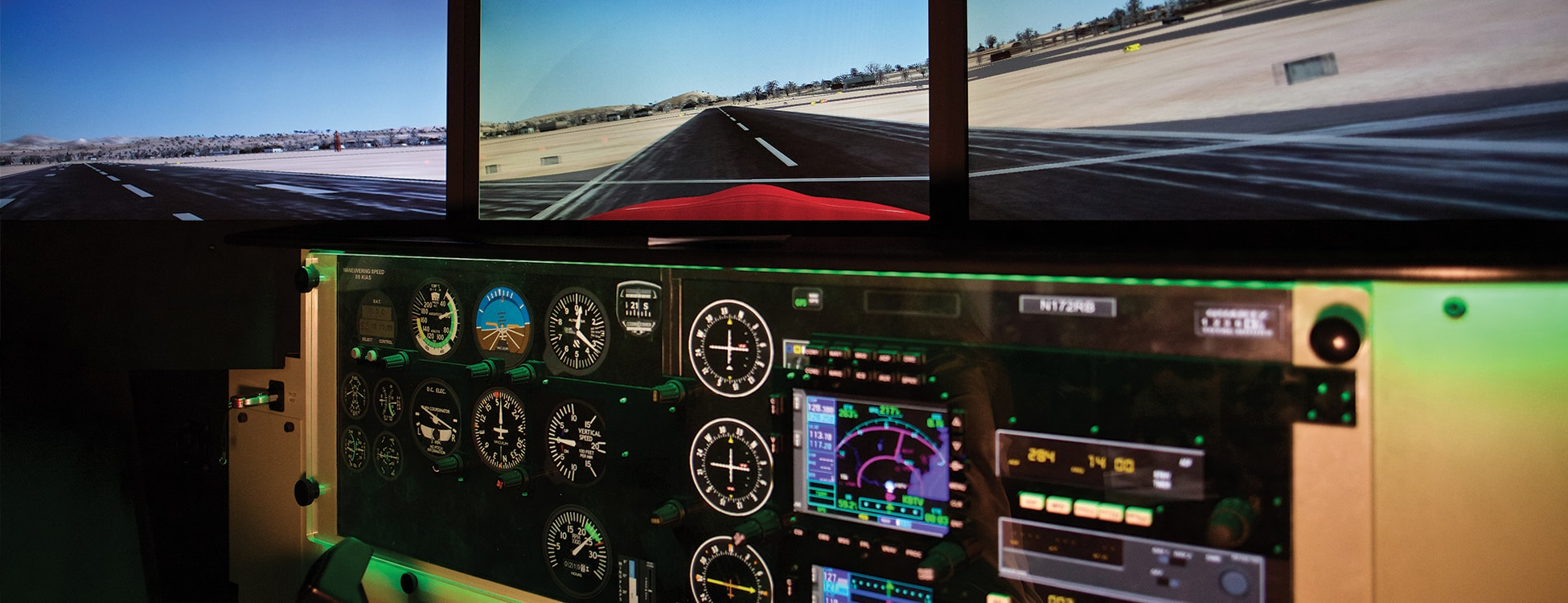 Professional Pilot flight simulator controls with screen showing a landing, Williston campus