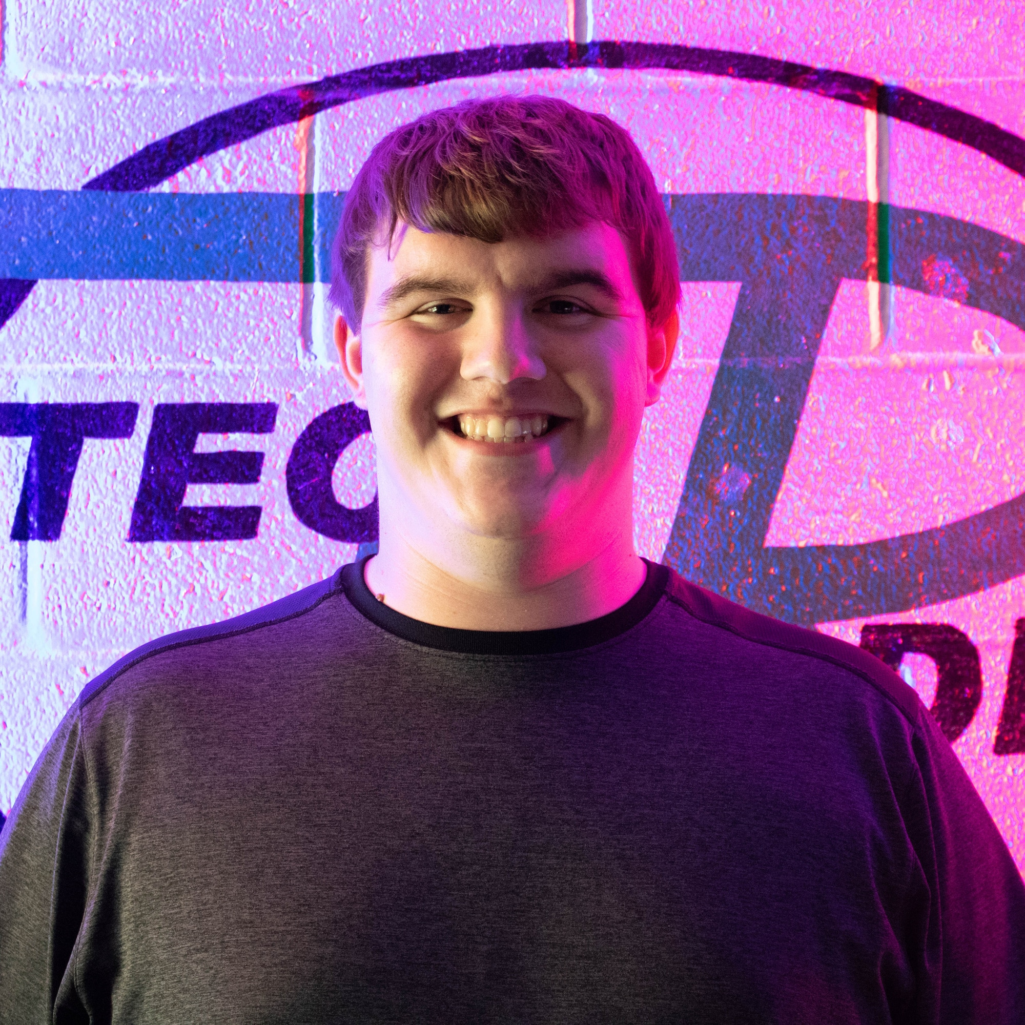 Zach Davis, student, in front of the WVTC sign on the wall