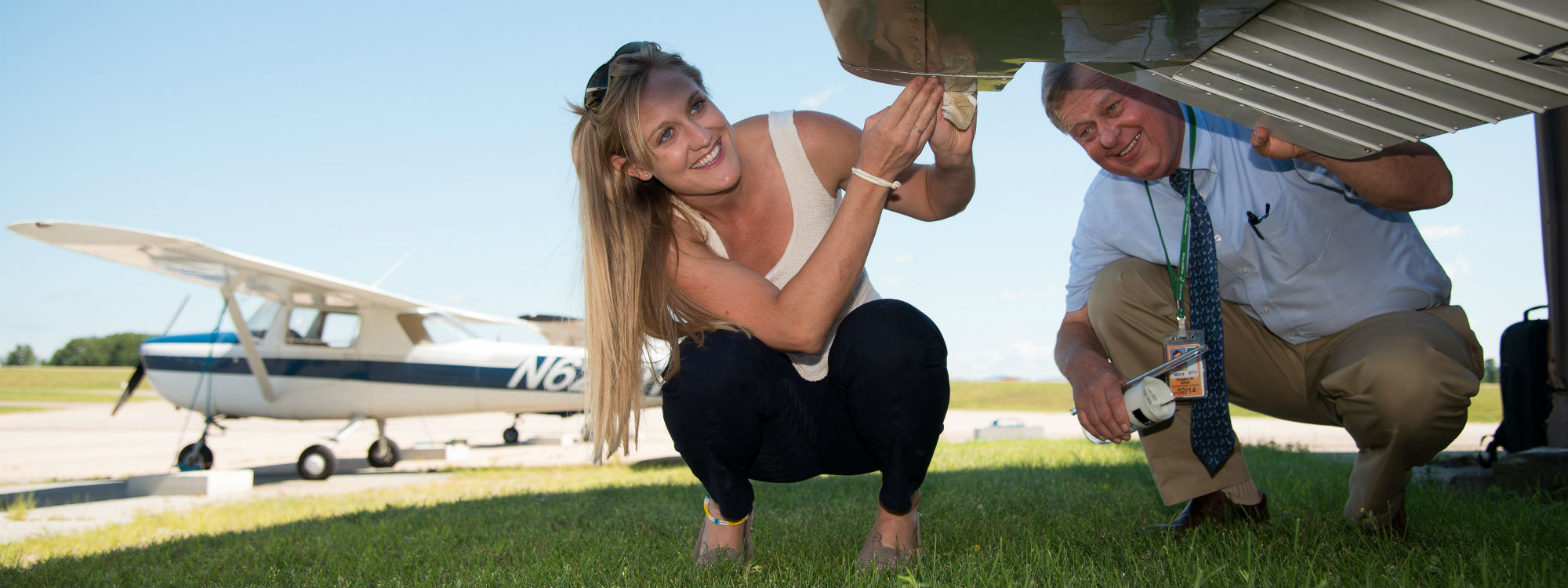 Jamie Heiam inspects a plane with professor Doug Smith before taking off in flight, STEM, hands on