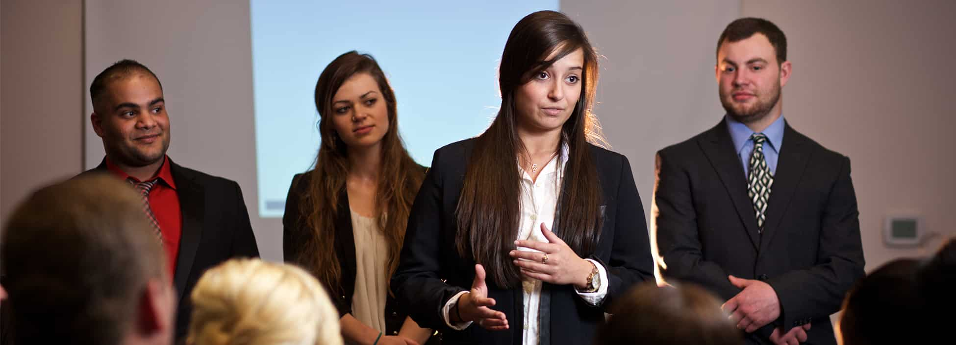 Students get practice with business presentations, business technology and management