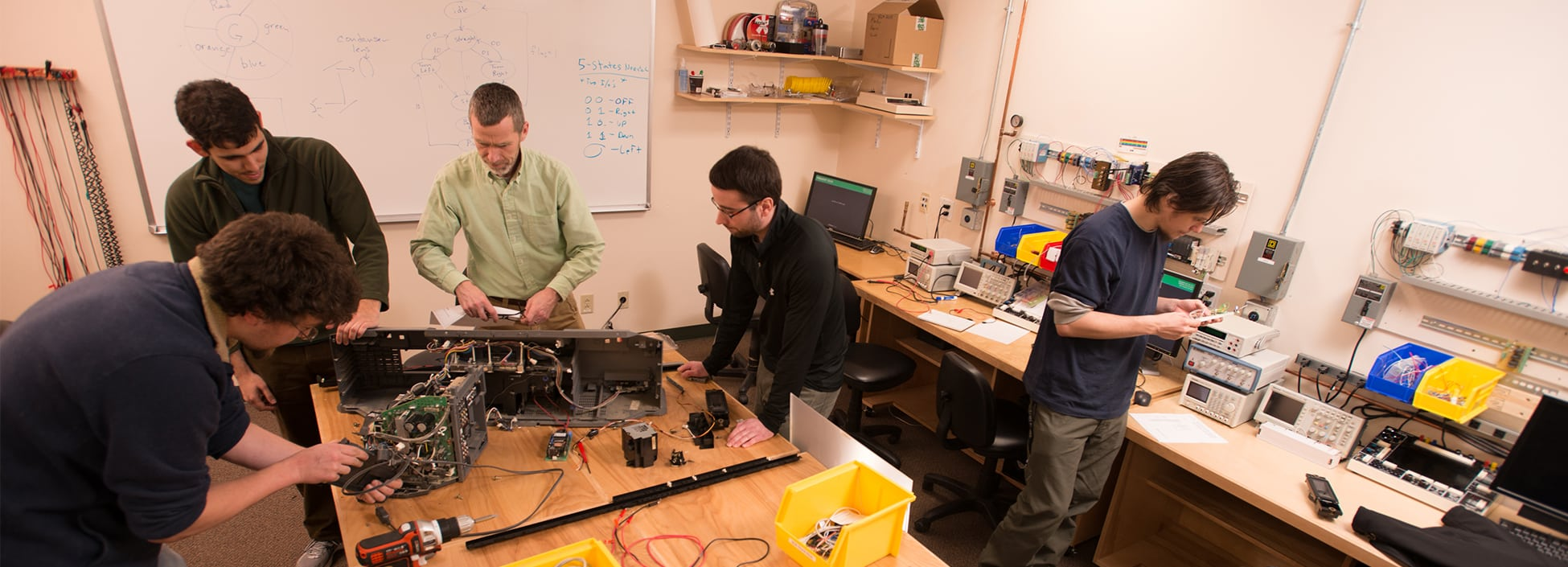 Students take apart a computer in the Computer Software Engineering lab, hands on