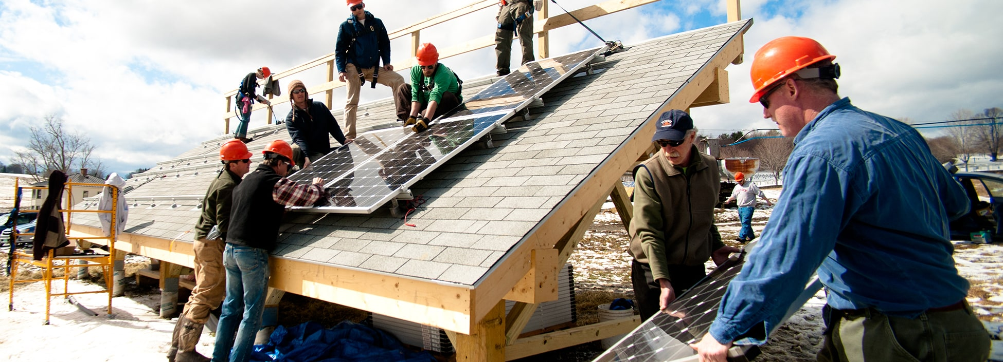 Students of the Renewable Energy program install solar panels at the Langevin house on the Randolph Center Campus, lab,  hands on
