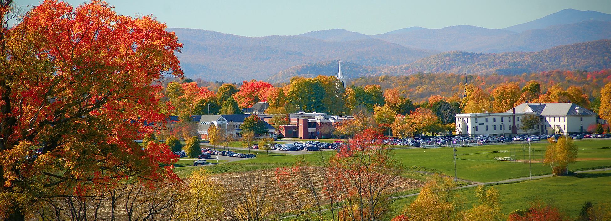 A view of the Randolph Center Campus in the fall, mountains