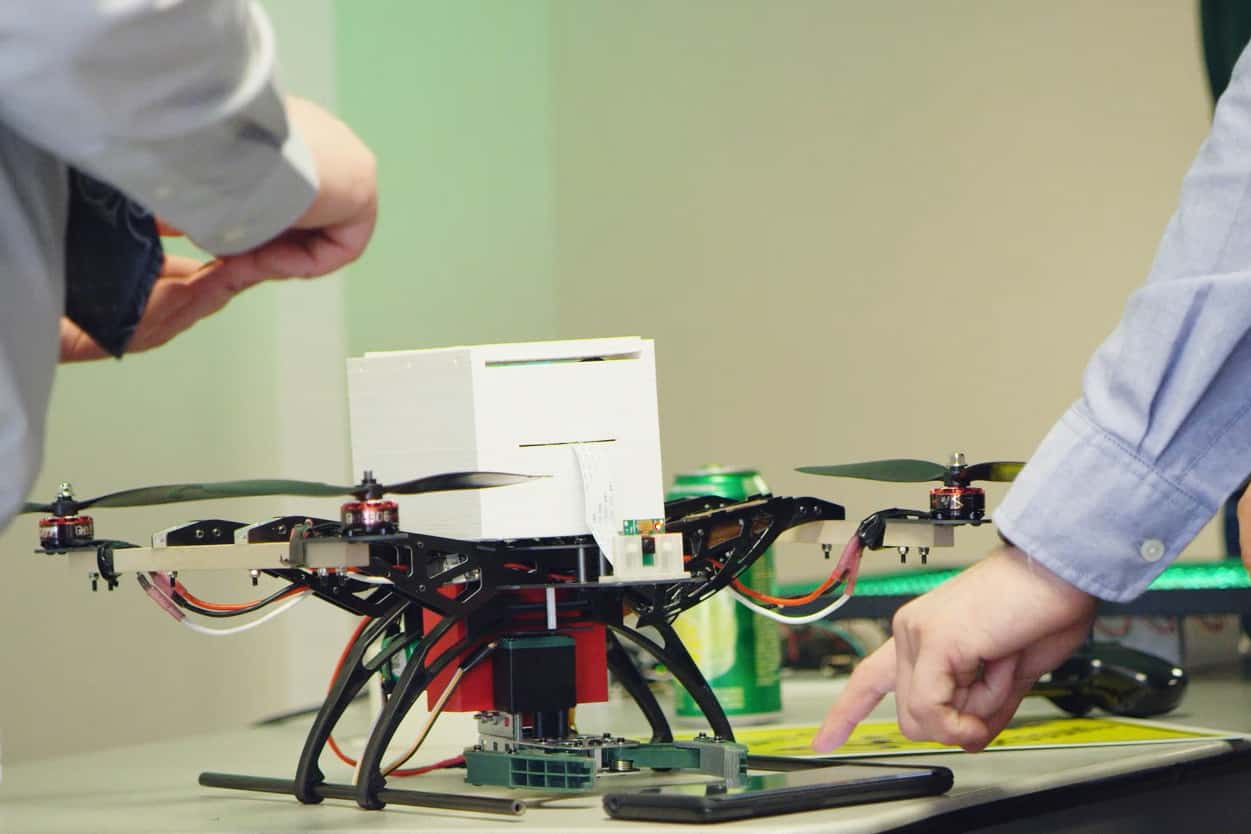 Logan, student uses an android phone to control the claw attachment of the drone, senior project