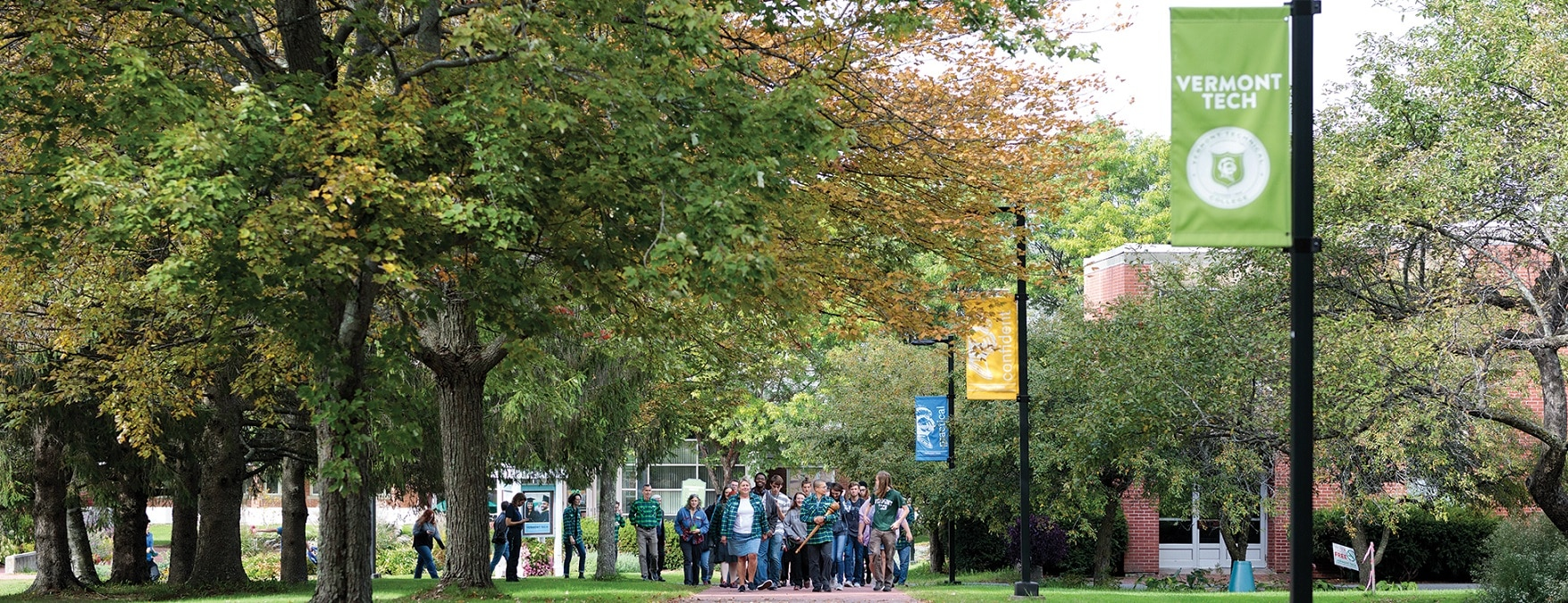 Students, faculty, and staff march up walkway, Randolph Center campus