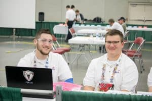 Tyler and Aric smile during their competition, SkillsUSA national competition