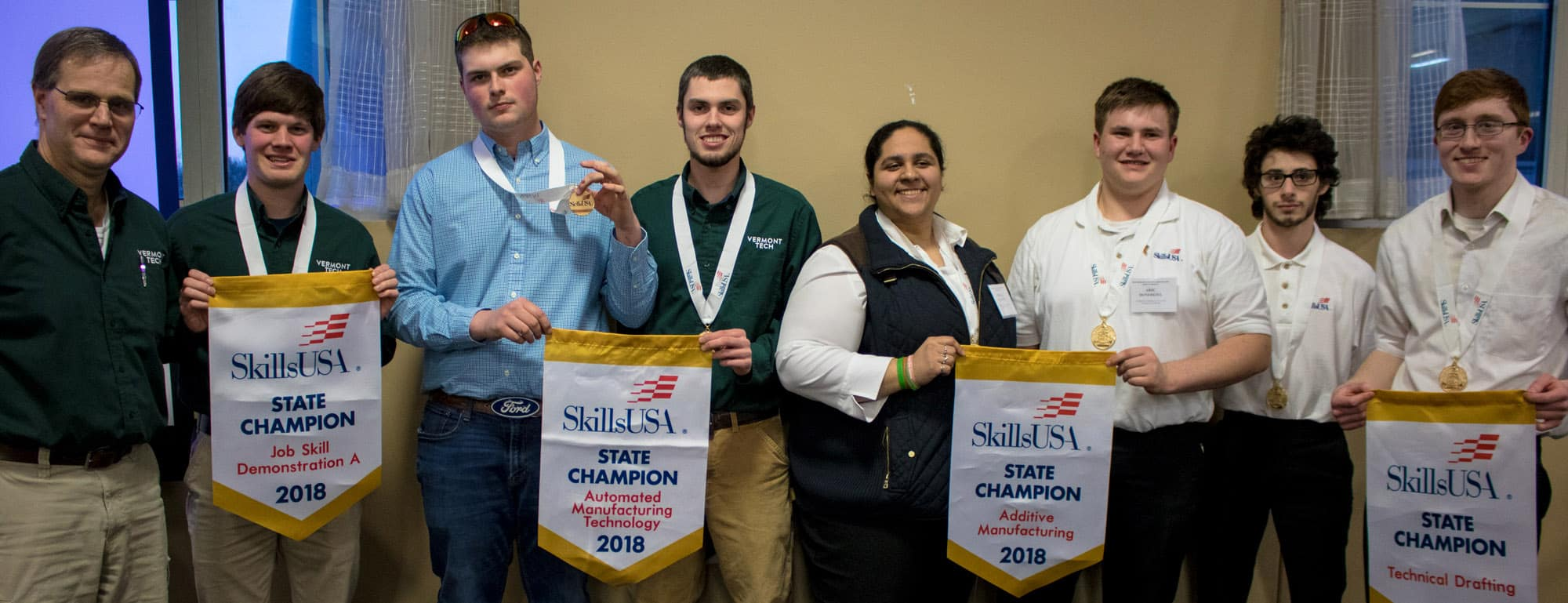 SkillsUSA, students win gold and bronze, flags, female students, male students, STEM