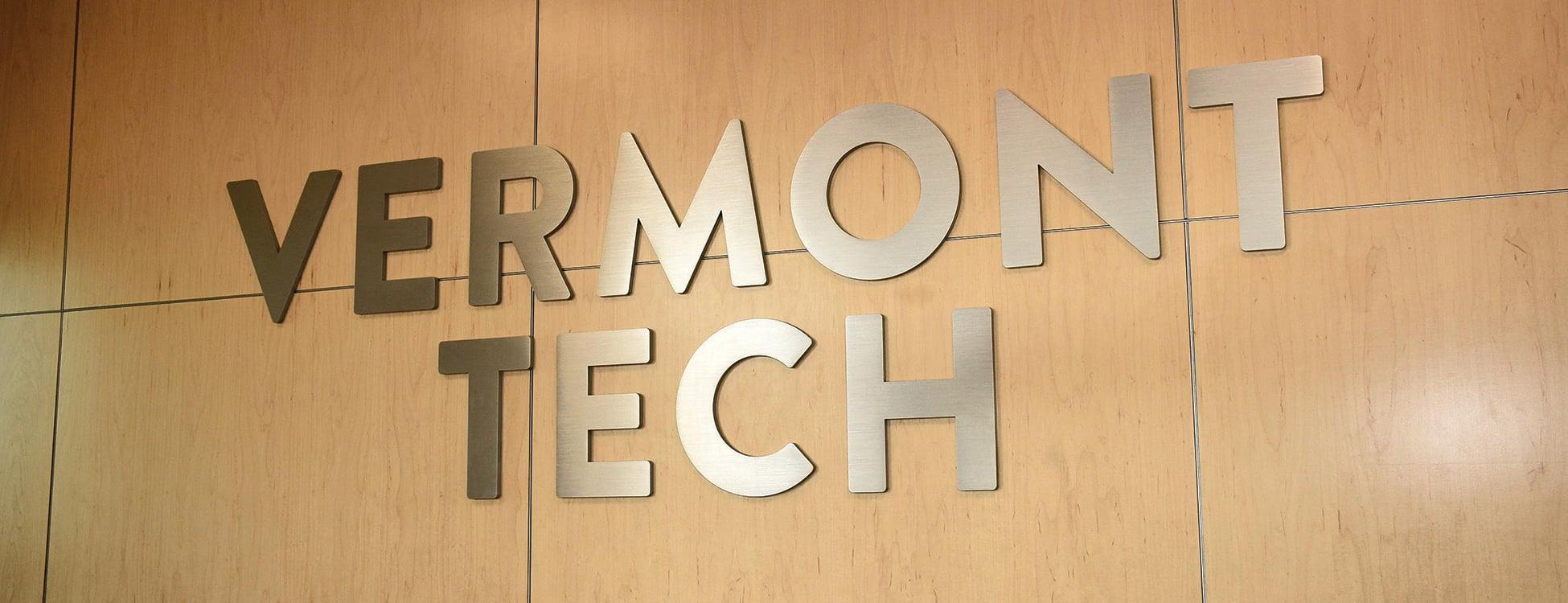 Vermont Tech Logo, wood, metal