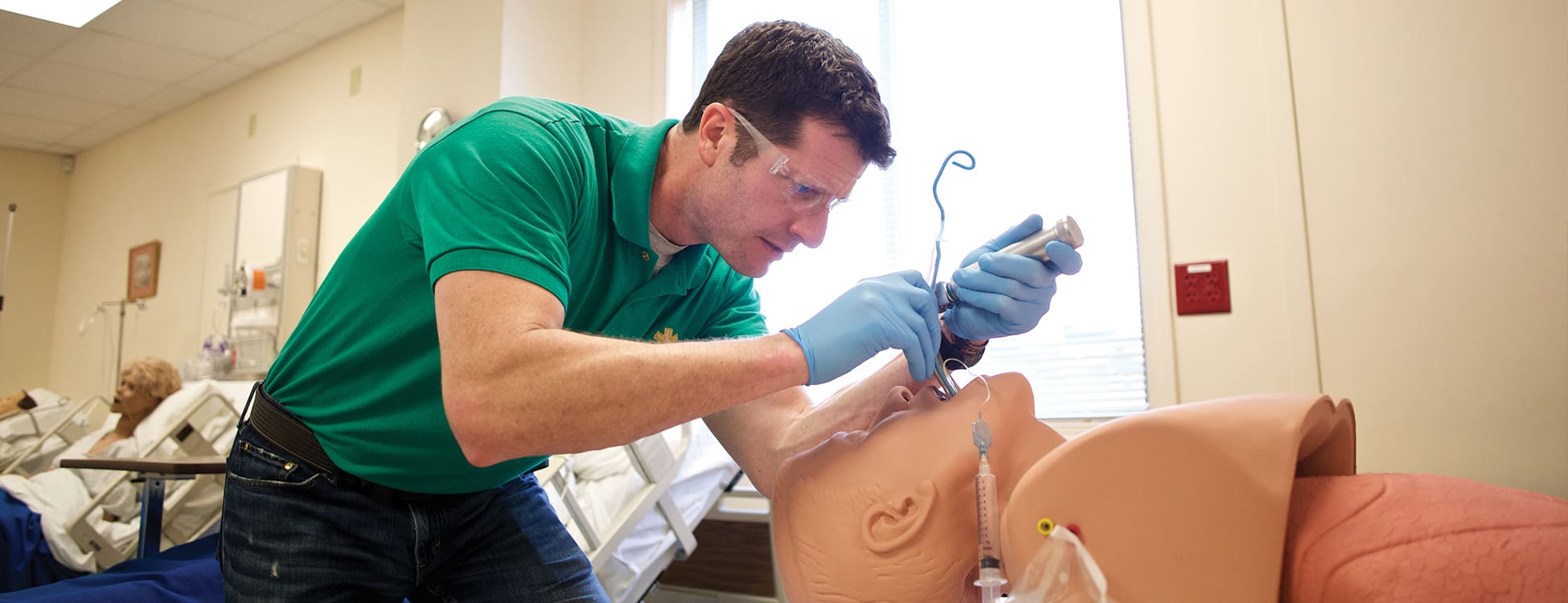 paramedicine, male students, simulation, hands on