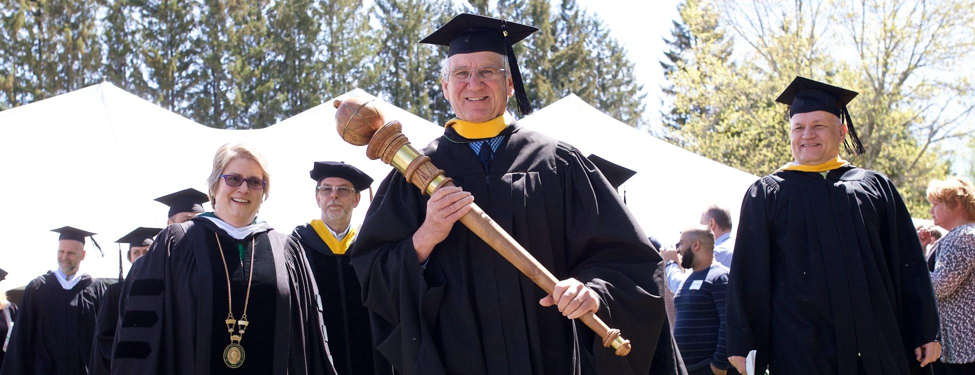 commencement, graduation, John Knox, sun, smiling