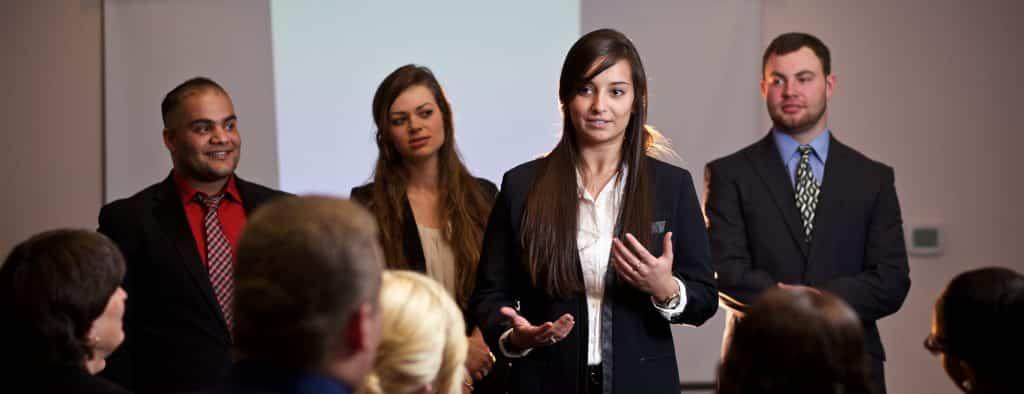 Business management students during their senior presentation, oral presentation, entrepreneurship, professional