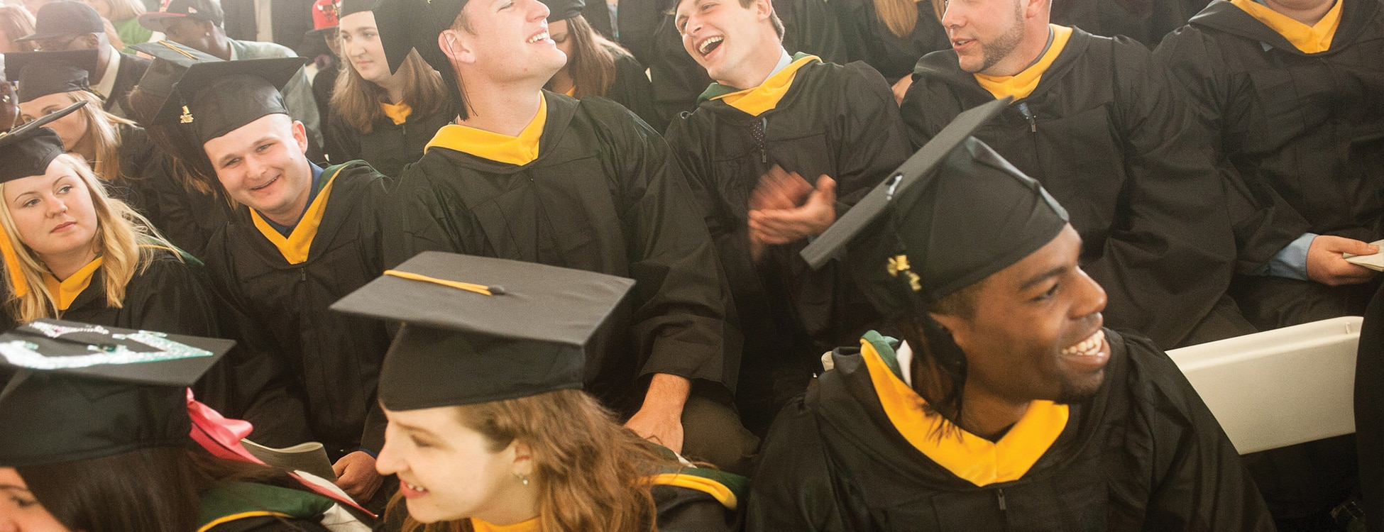 commencement, graduation, 99% placement rate, smiling