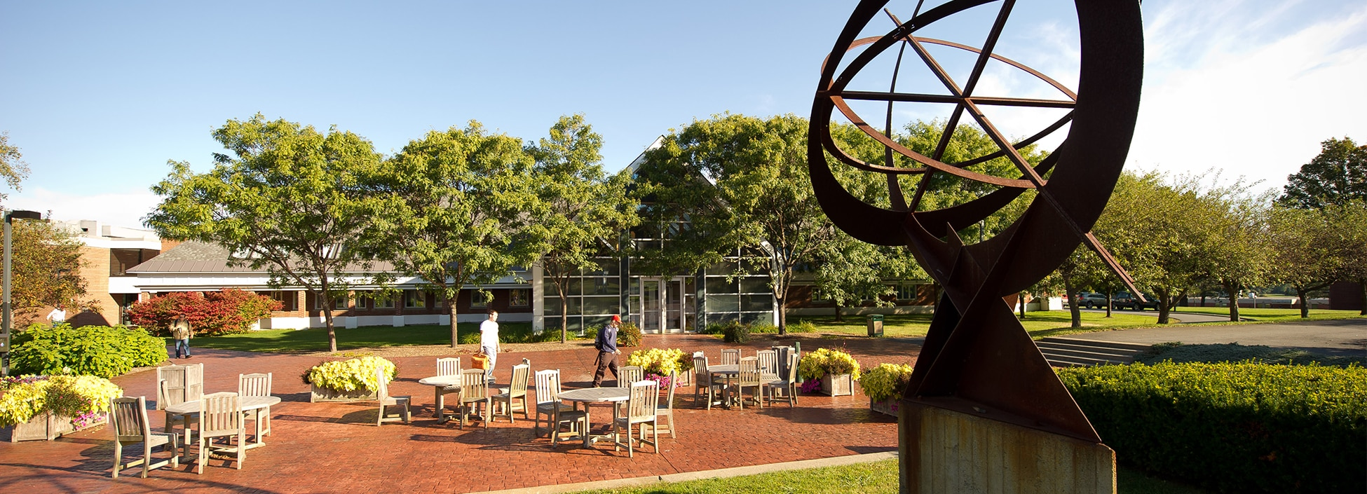 Randolph Center campus, plaza, patio, sculpture, sun, tables, relaxing