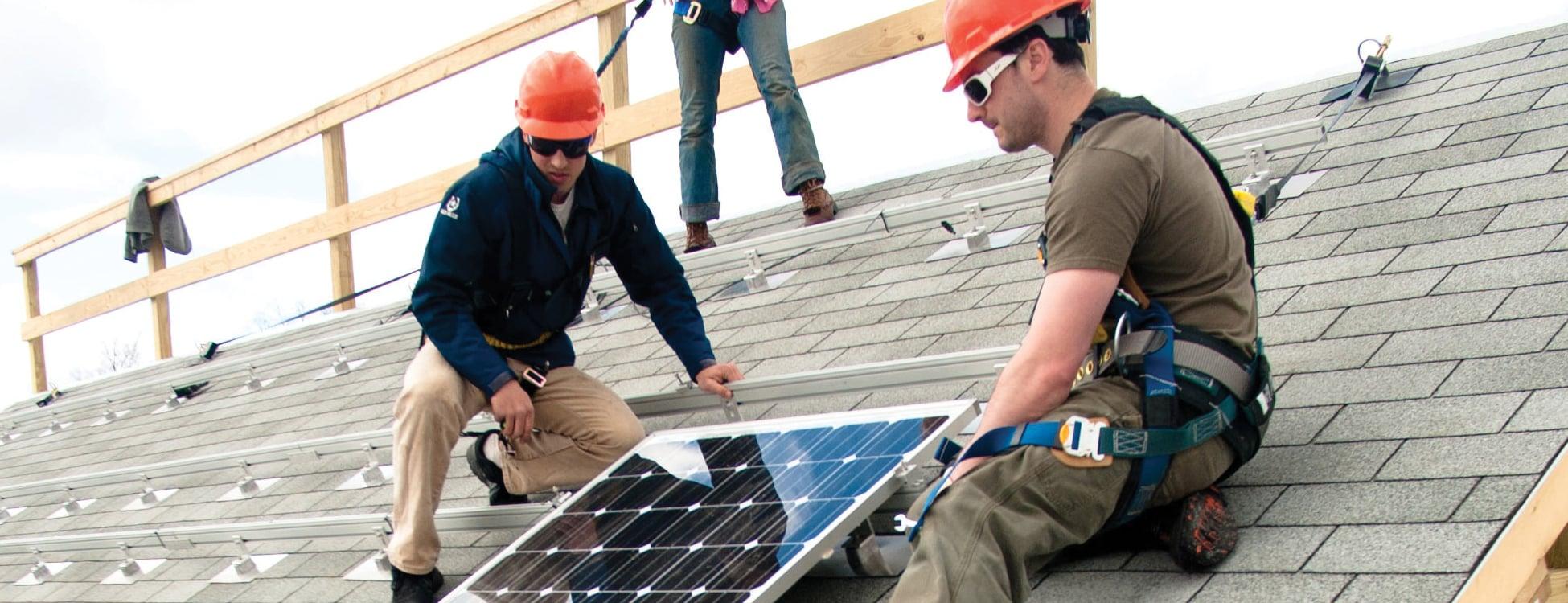 students installing solar panels, laboratory, hands on, renewable energy