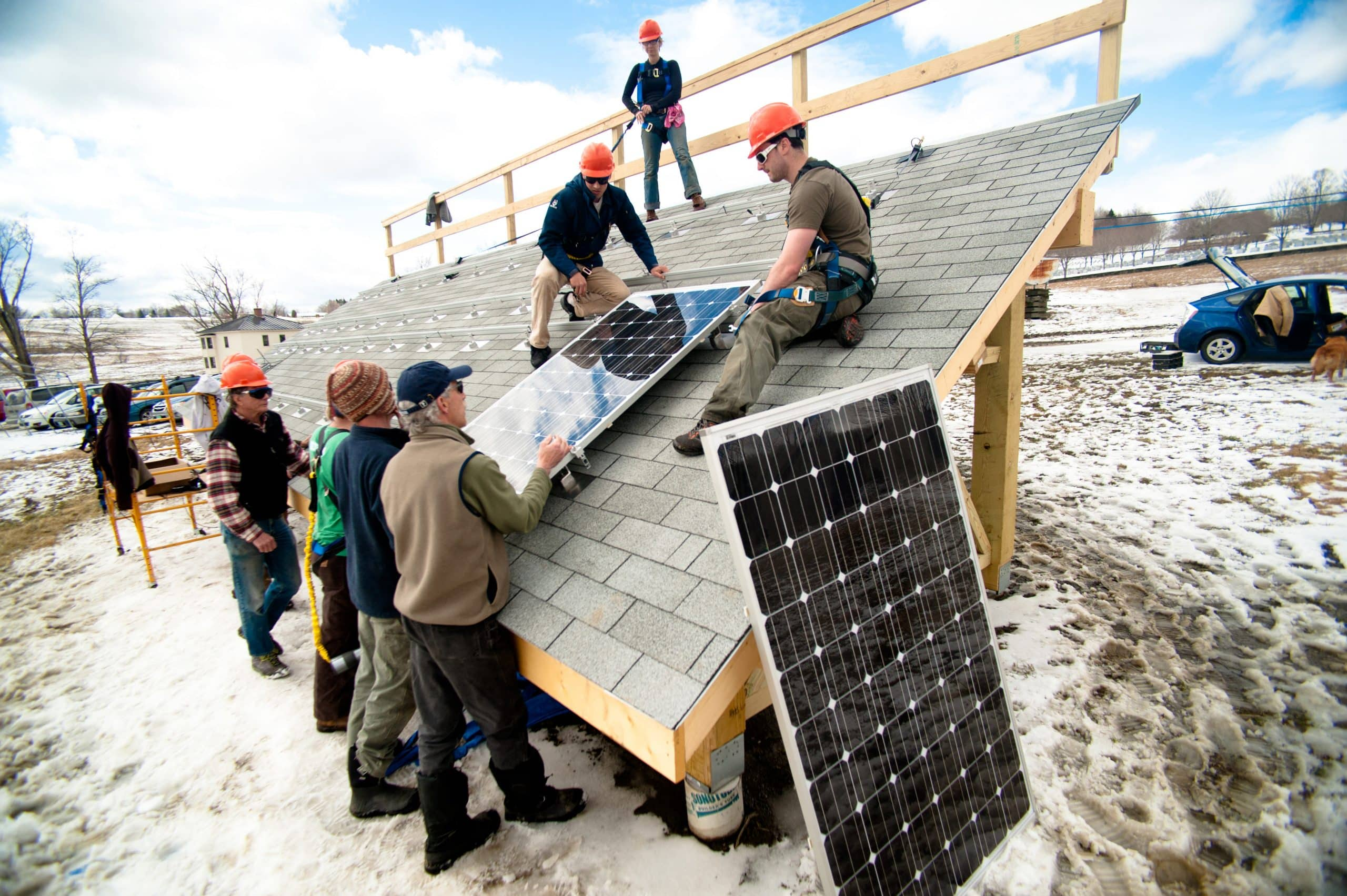 Students learning how to install a solar panel, Randolph Center campus