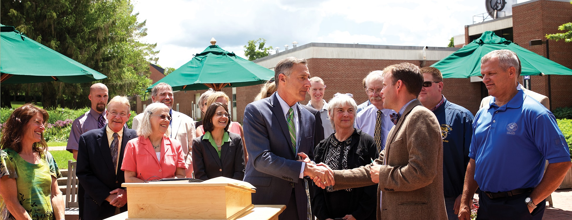 Governor Shumlin, Vermont, shaking hands, outside, press conference, Randolph Center campus