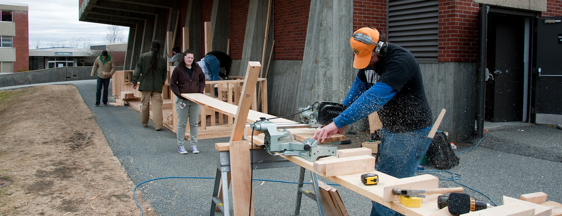 Students outside working, power saws