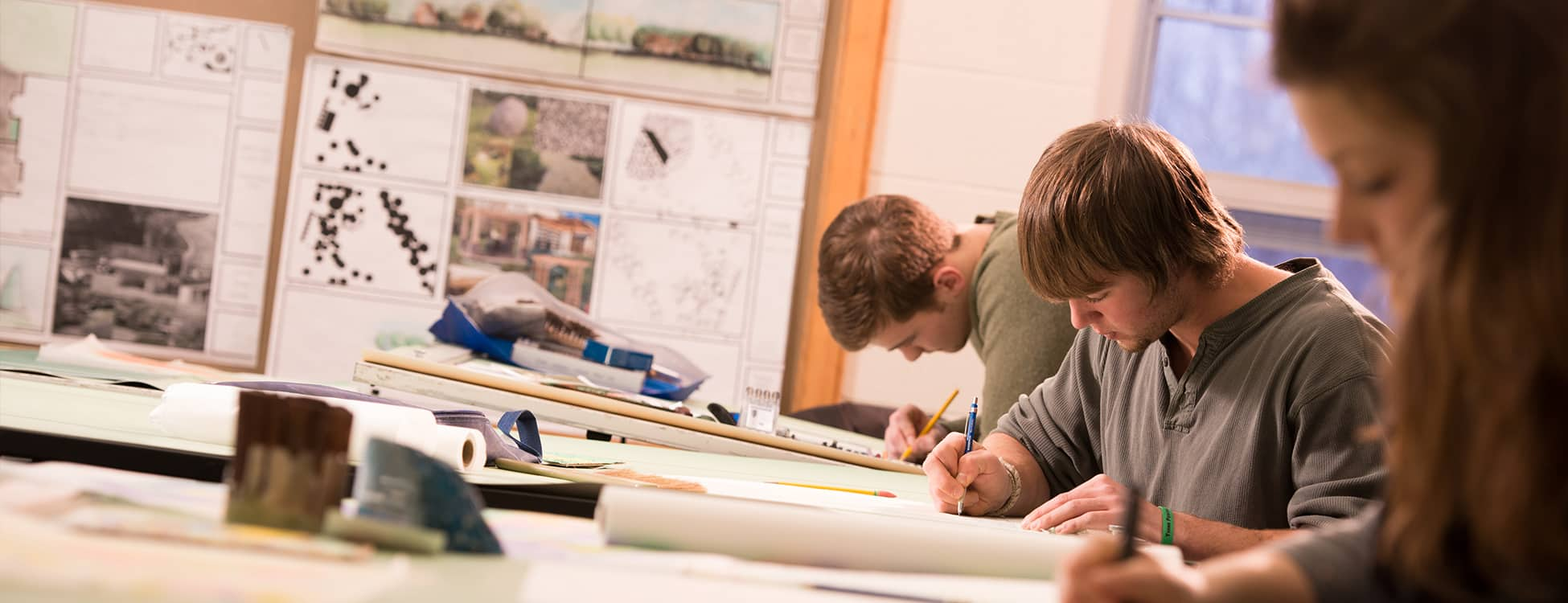 Students working in the landscape lab, drawing, drafting tables