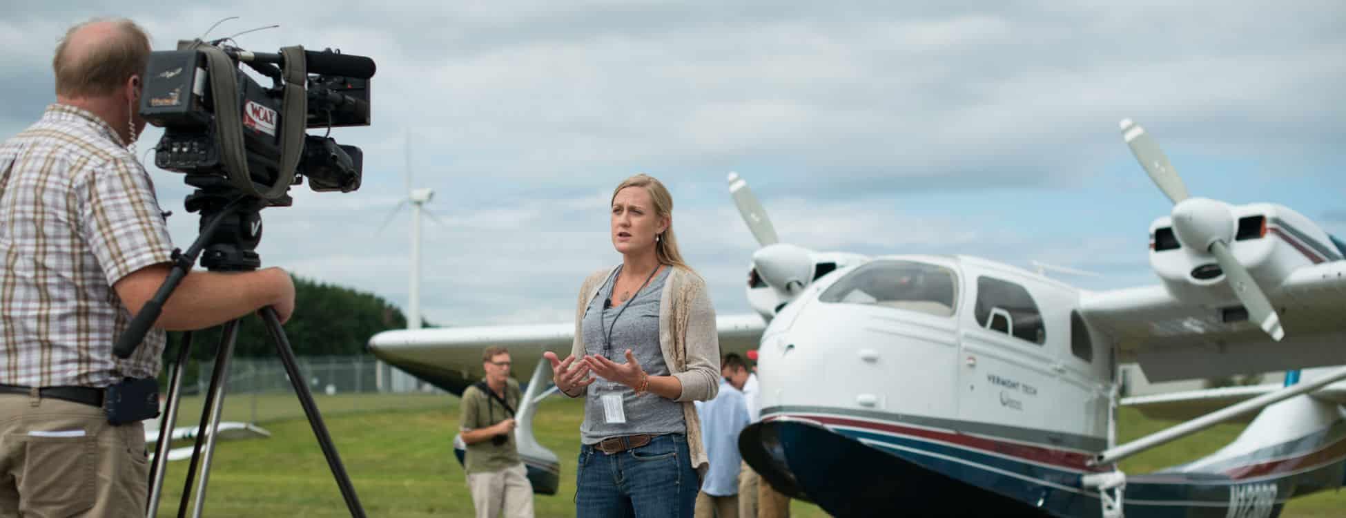 female student, professional pilot technology, sea plane, press conference