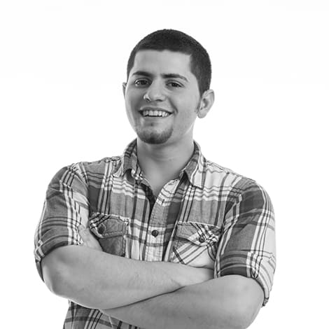 male student, Matt Fransoza, smiling, arms crossed