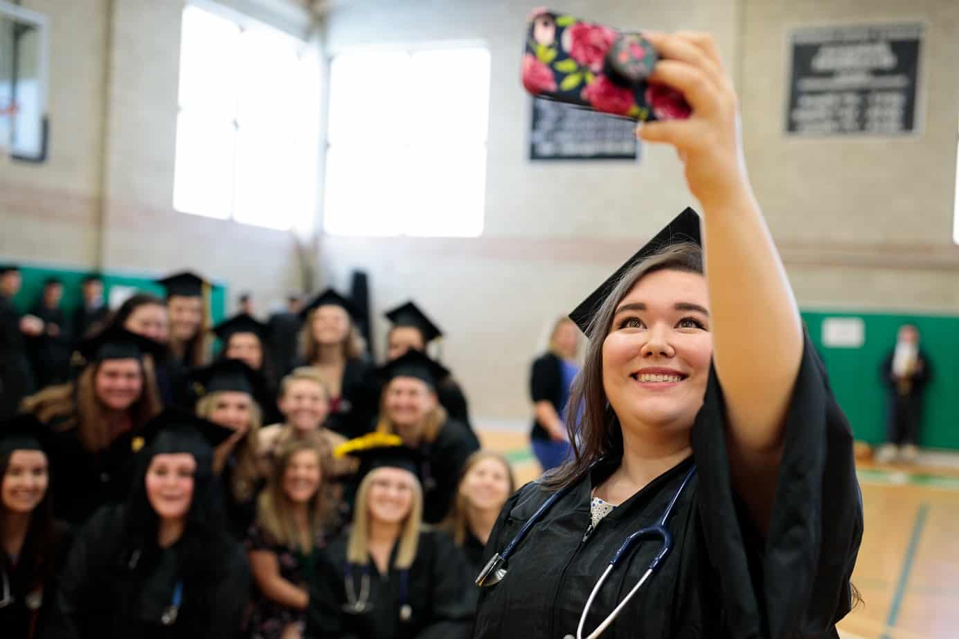 Female students, commencement, graduation, group posing for selfie