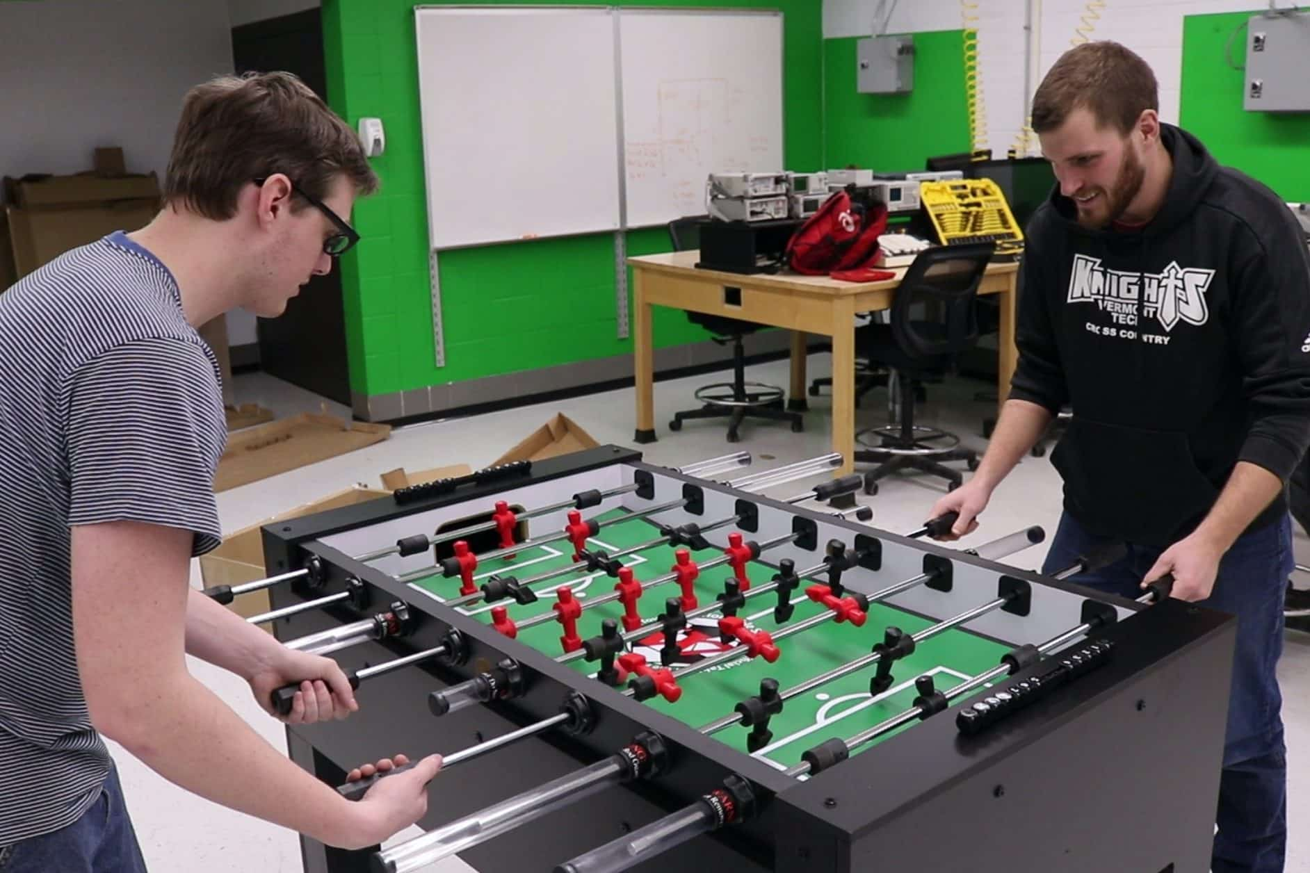 male students build foosball table, senior project, lab