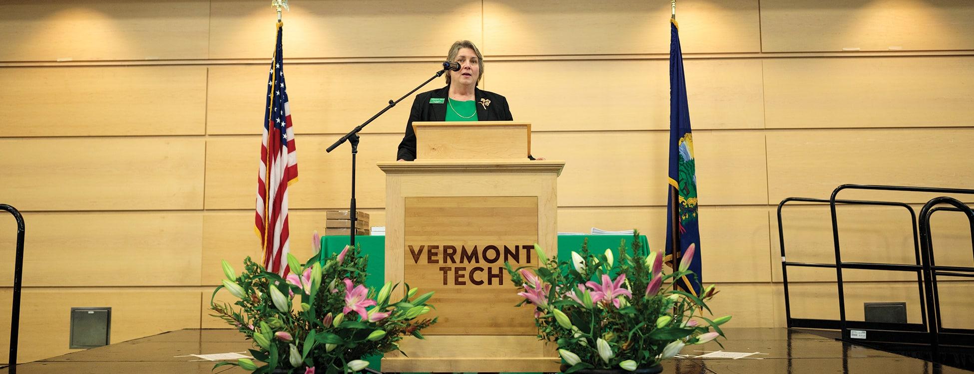 President Patricia Moulton, speaking, podium