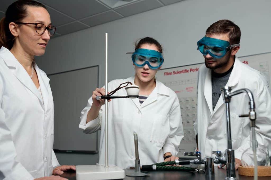 Female student, male student, faculty, science lab, PPE