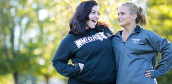 Female students, hug, smiling, outside