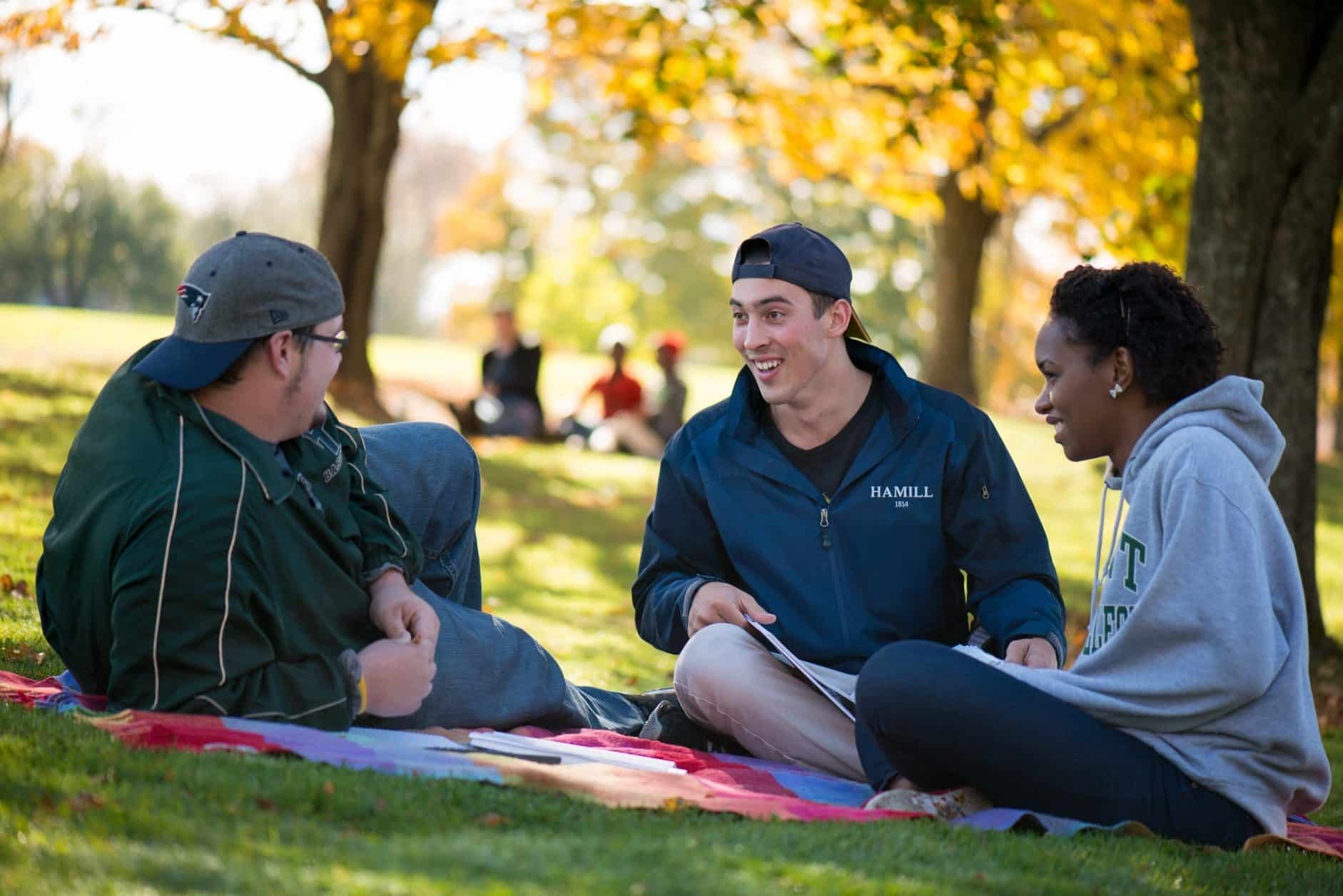 Female students, male students, diversity, autumn in Vermont, trees, relaxing, chatting